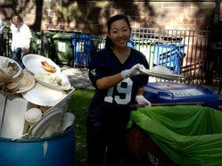 Student worker helps sort recycling and composting