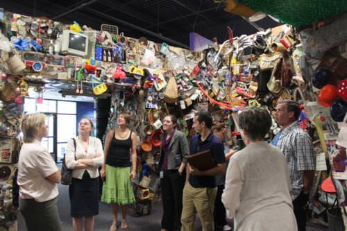 The group toured the plant's Trash Museum prior to touring the facilities.