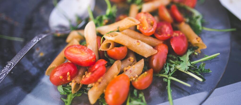 plate with pasta and tomatoes