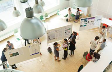 Conference participants at a poster session.