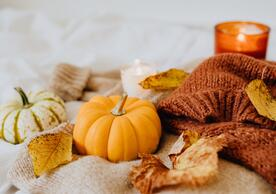 pumpkins and scarf on a table